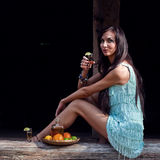 Young beauty with tequila in the old wooden house Royalty Free Stock Photo