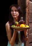 Young beauty with tequila in the old wooden house. The young beauty with tequila in the old wooden house Royalty Free Stock Image