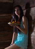 Young beauty with tequila in the old wooden house Royalty Free Stock Images