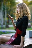 Young beauty woman autumn with phone Royalty Free Stock Photos