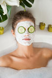 Young beauty woman in the bath with face mask Royalty Free Stock Photos