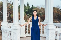 Young beauty woman in a blue dress Royalty Free Stock Photo