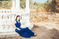 Young beauty woman in a blue dress Stock Photography