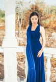 Young beauty woman in a blue dress. Walking in a park Stock Images