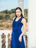 Young beauty woman in a blue dress. Walking in a park Royalty Free Stock Photography