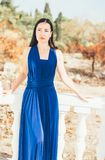 Young beauty woman in a blue dress. Walking in a park Stock Photography