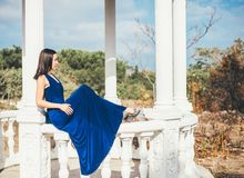 Young beauty woman in a blue dress Royalty Free Stock Photos
