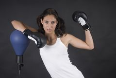 Young beauty woman boxer fighting with punch Stock Image