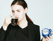Young beauty woman in business style costume waking up for work Stock Photo