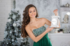 Young beauty woman with Christmas candles, new year tree backgro Stock Photography