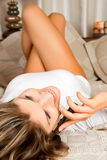 Young beauty woman couch in the bed Stock Image