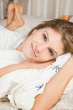 Young beauty woman couch in the bed Royalty Free Stock Image