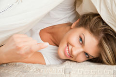 Young beauty woman couch in the bed Stock Images