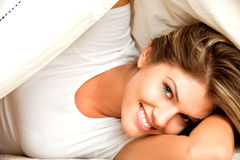 Young beauty woman couch in the bed Royalty Free Stock Photography