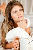 Young beauty woman couch in the bed with a mug Stock Images