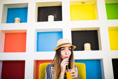 Young beauty woman drink tasty juice in cafeteria, Summer time vocation. Stock Images