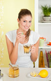 Young, beauty woman drinking a cup of tea Royalty Free Stock Images