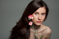 Young beauty woman with flower Stock Photography