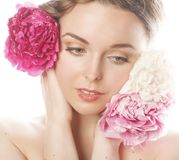Young beauty woman with flower peony pink closeup Royalty Free Stock Photos