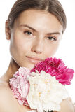 Young beauty woman with flower peony pink closeup Royalty Free Stock Photo