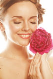 Young beauty woman with flower peony pink closeup makeup soft tender gentle look Royalty Free Stock Photos