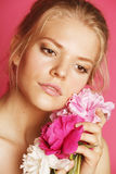 Young beauty woman with flower peony pink closeup makeup soft tender gentle look Royalty Free Stock Images