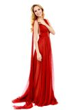 Young beauty woman in fluttering red dress Royalty Free Stock Photos