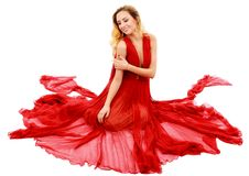 Young beauty woman in fluttering red dress Stock Image