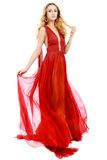 Young beauty woman in fluttering red dress Stock Photo