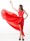 Young beauty woman in fluttering red dress Royalty Free Stock Photography