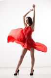 Young beauty woman in fluttering red dress Stock Images