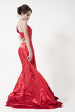 Young beauty woman in fluttering red dress. White background. Stock Image