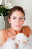 Young beauty woman in the full of foam bathtub Royalty Free Stock Photos