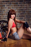 Young beauty woman in garage Royalty Free Stock Photo