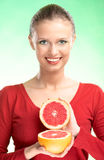Young beauty woman with grapefruit Stock Photos