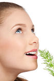 Young beauty woman with green dill Stock Images