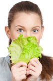 Young beauty woman with green lettuce Stock Photography