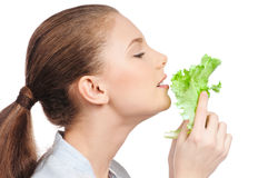 Young beauty woman with green lettuce Stock Photos