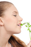 Young beauty woman with green parsley Stock Images