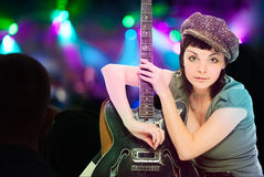 Young beauty woman with guitar Royalty Free Stock Photos