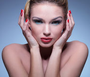 Young beauty woman holding her face in her palms stock images