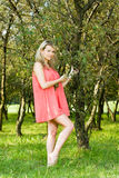 Young beauty woman holding tree branch in orchard Royalty Free Stock Photos