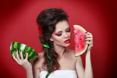 Young beauty woman holding watermelon Stock Image