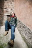 Young Beauty Woman Laying On Concrete Wall. Old Italy Series Stock Photography