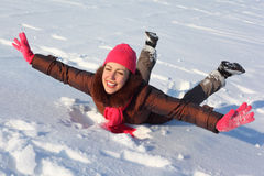 Young beauty woman lies on snow Stock Images