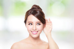 Young Beauty woman listen by ear. With health skin and teeth, with nature green background, asian Royalty Free Stock Photos