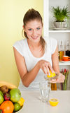 Young beauty woman make lemon juice Stock Images