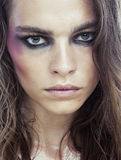 Young beauty woman with makeup like shiner on face Royalty Free Stock Photos