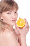 Young beauty woman with orange Royalty Free Stock Photos