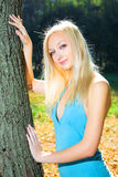 Young beauty woman in park Stock Images